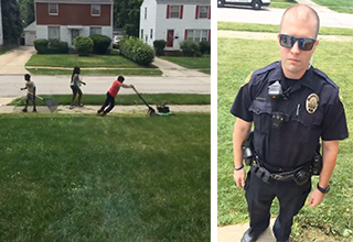 A group of kids are seen mowing their grandmothers lawn. On the right is a police officer standing on the lawn speaking with the kid's grandmother.
