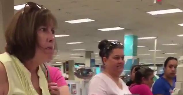 a lady in a yellow shirt looking angrily at a cashier