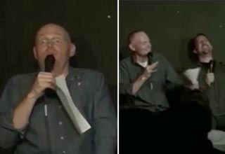 bill burr looking startled on stage, and laughing with other comics