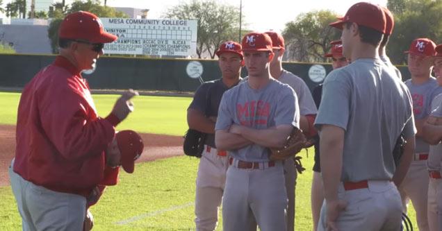 a baseball coach talks to his team