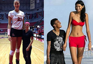 a tall basketball player and a tall lady in a bathing suit standing next to someone who is shorter than them
