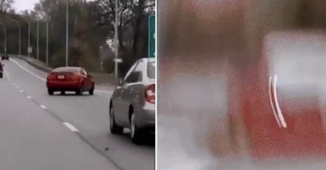 a car swerving on the road, the cameraman's camera goes blurry
