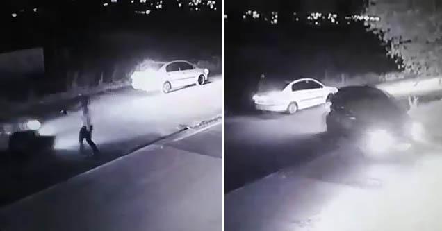 A man holding a gun at a car, and a car backing up into his car