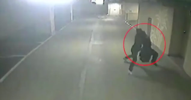 woman being kidnapped in a dark alley