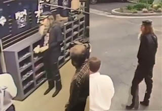 sacha baron cohen standing inside a gunstore and then walking away from it