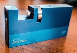 a metal box with silver parts called the lotus puzzle
