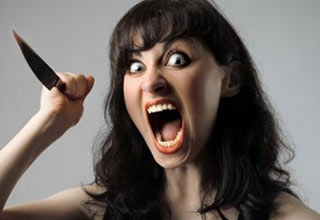 an angry woman screaming and holding a knife in the air