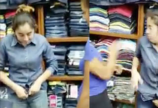 a woman trying on jeans at a store and then getting slapped hard