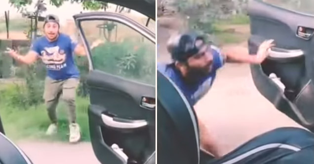 a man outside of the car doing the shiggy dance runs into a pole and falls trying to get back in his car