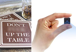 a coaster that says don't ef up the table, and a very small spy camera