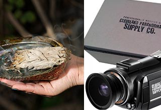 a bundle of white sage burning and a camera for filming ghosts