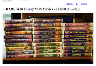 a stack of disney vhs's for sail for $13,080