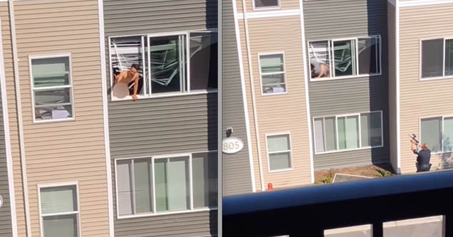 A naked man is hanging out of his window in Bellingham, Washington on August 4, 2018.