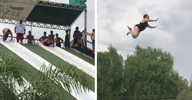 a heavy set woman in a black bathing suite going down a waterslide and flying through the air