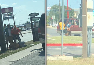 A man is lying on the ground as a group of people surround him an an apparent attempted kidnapping in San Antonio, Texas in 2018.