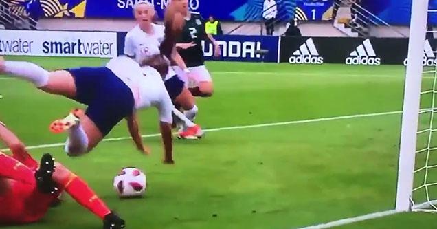 a falling over a ball near a goal
