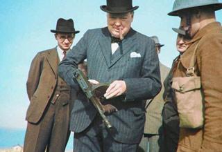 winston churchill holding a tommy gun