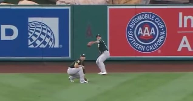 oakland as outfielder ramon laureano throws the ball 321 feet to first base