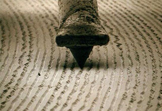 close up of a record needle playing a record