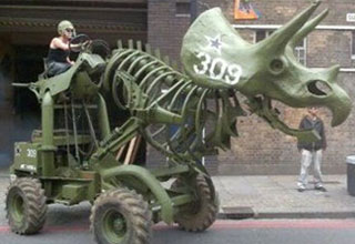 a triceratops tank being driven by a man in a helmet