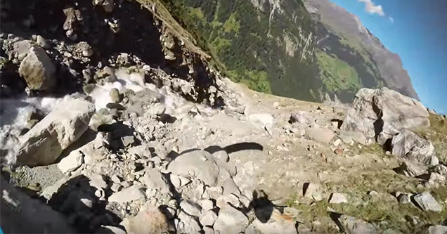 flying down a mountain in a parachute