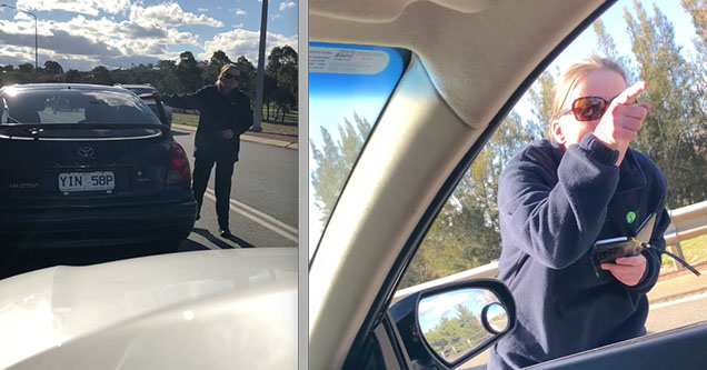 A woman is standing outside of a man's car after she stopped her car, causing a huge backup in traffic, in Australia in 2018.