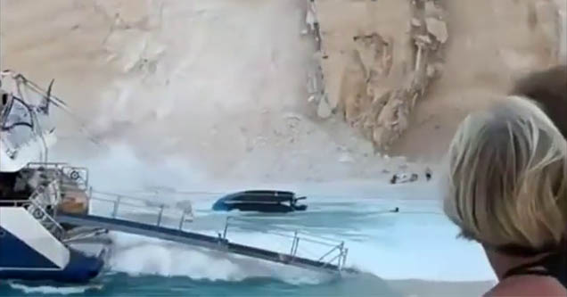 a mass of dirt falling into the water at shipwreck beach