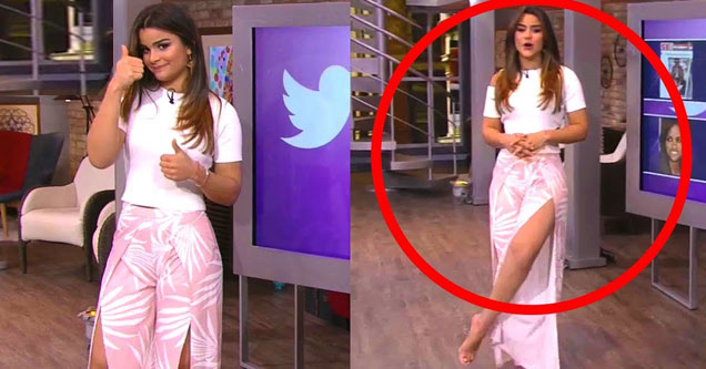 a very attractive latina tv personality in a long dress showing her leg