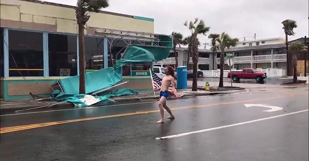 Guy standing in the road during hurricane florence