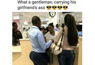 a photo of a ups employee taking pictures with packages and a man with a bigger butt than his girlfriend