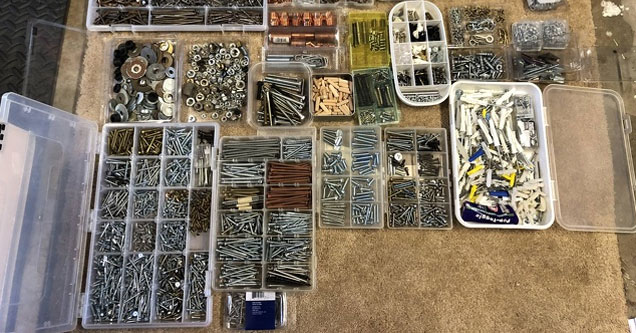 a bunch of tool boxes and containers organized with screws and nails