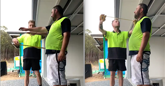 A construction worker is using a measuring tape to play a prank on a coworker in Australia in 2018.