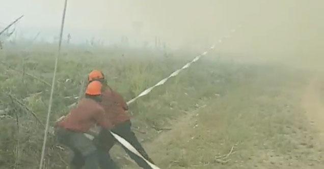 firefighters play tugofwar against firenado