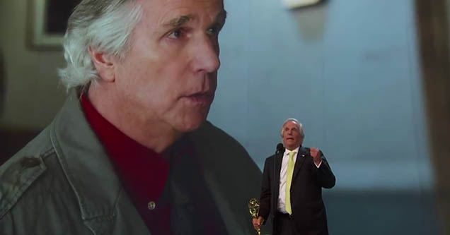 henry winkler giving a speech on the stage of the emmy's