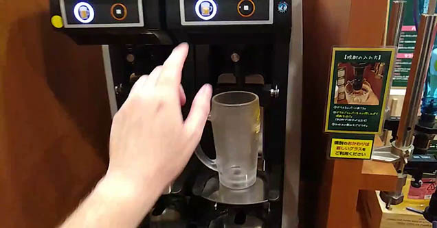 a man about to activate a beer pouring machine