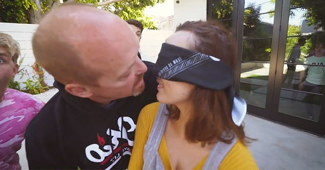 Greg Paul kissing a blindfolded girl for youtube