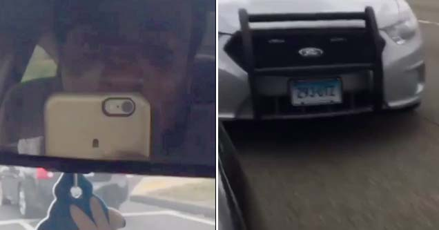 a man filming himself in the mirror of his car, a cop car speeding behind him