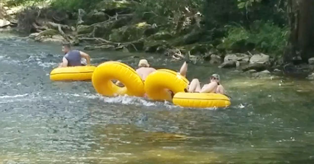 A group of people are gloating down a river near the Smoky Mountains in 2018.