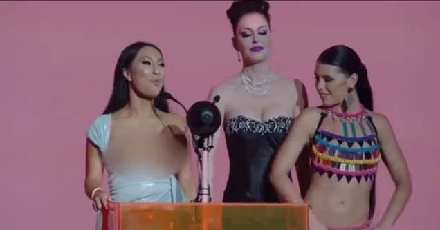 three ladies at the podium of the pornhub awards ceremony