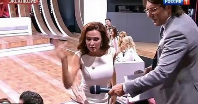 russian actress in a white dress slaps a woman