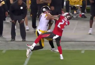 Vance McDonald throws Chris Conte to the ground