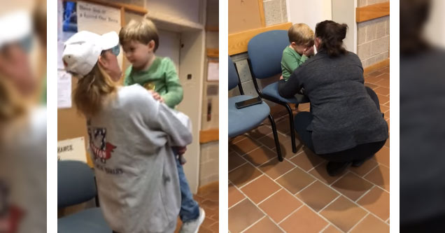 a young boy in a green shirt and blue jeans being comforted by two women after hearing he has to go back to his mother