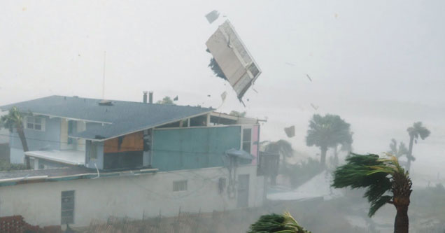 Roof flying off a house in Panama City Beach during Hurricane Michael