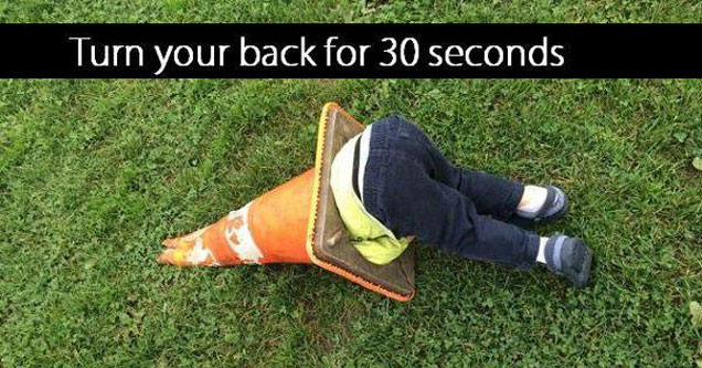 Kid stuck inside a traffic cone with the text 'turn your back for 30 seconds'