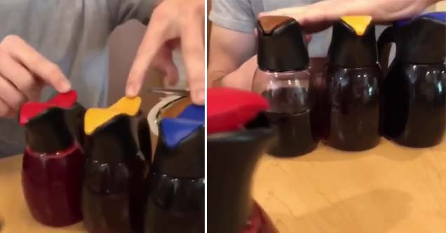 syrup on a table on a ihop being pressed by one dude