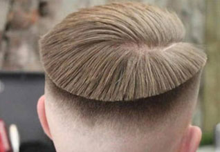 a photo of the back of a mans head with  super high up bowl cut fade
