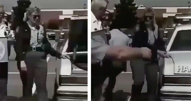 police officer with hand in trunk