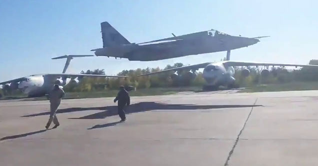 Ukrainian Flyby with people standing on runway.