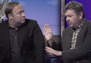 alex jones talking with another guest on a bbc show