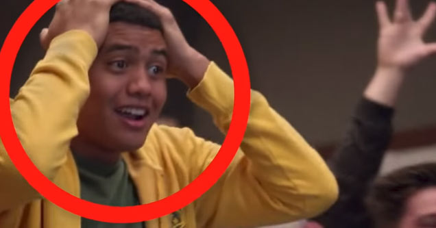 a young man in a yellow hoodie with his hands on his head and a red circle round his face